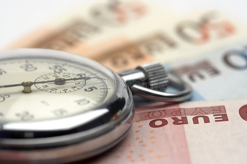 Tijd en geld royalty-vrije stock afbeelding