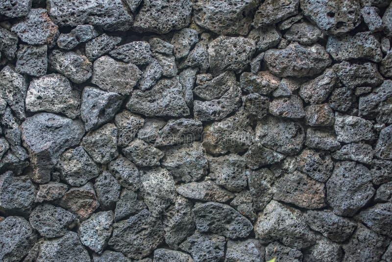 Tijolos de pedra do fundo da textura do vulcão na parede fotografia de stock royalty free