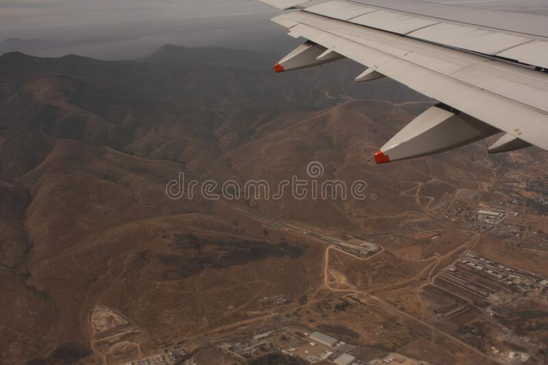 Tijuana Mexico zone in mountain range aerial view. Landscape aerial shot mountainous chain that in aerial shot allows to see a strip of the city of Tijuana royalty free stock photo