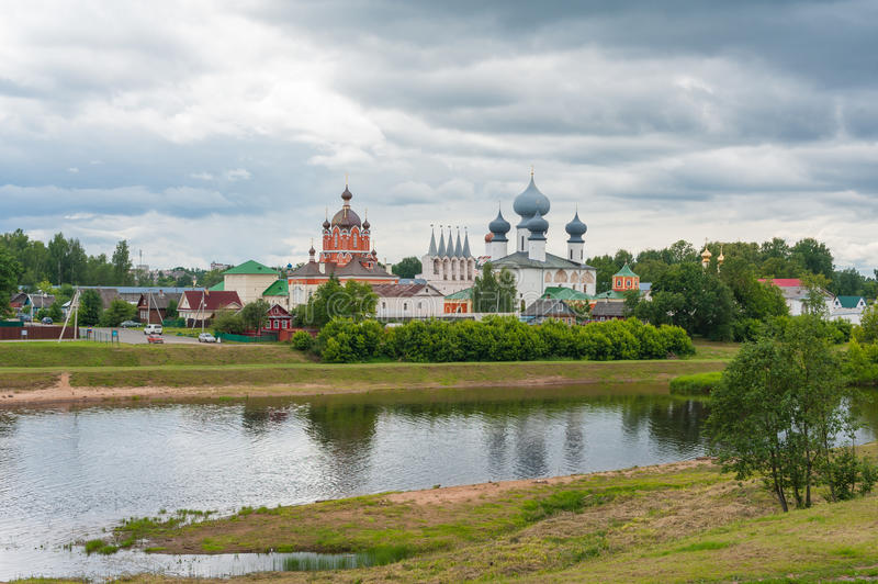 Tikhvin Assumption Monastery. View of the Tikhvin Assumption Monastery in Tikhvin, Russia, with the Tikhvinka river in the foreground stock images