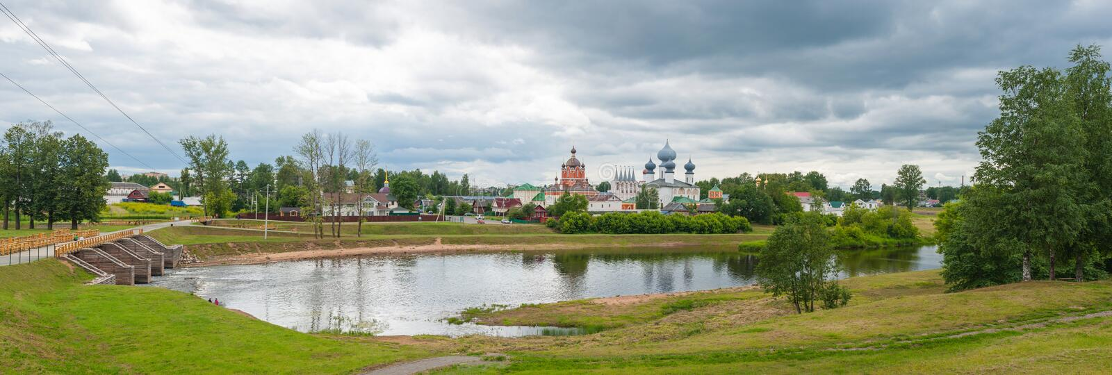 Tikhvin Assumption Monastery. View of the Tikhvin Assumption Monastery in Tikhvin, Russia, with the Tikhvinka river in the foreground stock photos