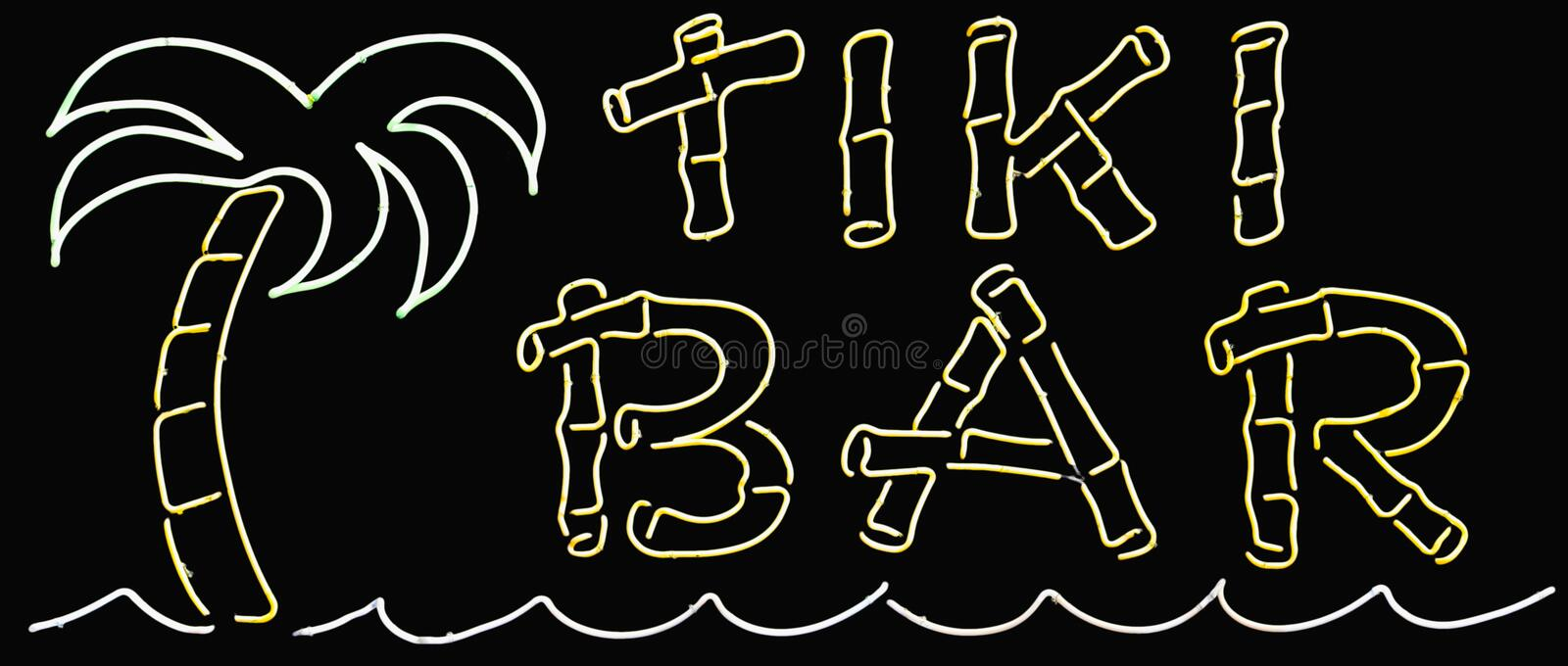 Tiki Bar Sign. A neon glowing tiki bar sign royalty free stock photography