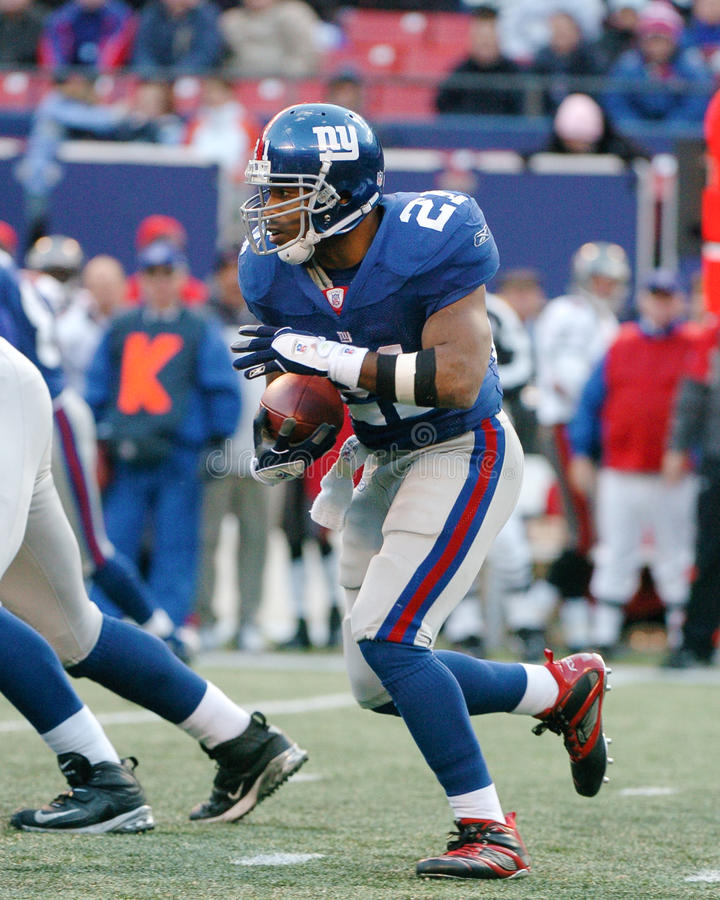 Tiki Barber. Running Back Tiki Barber of the New York Giants in game action againist the Dallas Cowboys. The New York Giants went on to defeat the Dallas Cowboys royalty free stock photography