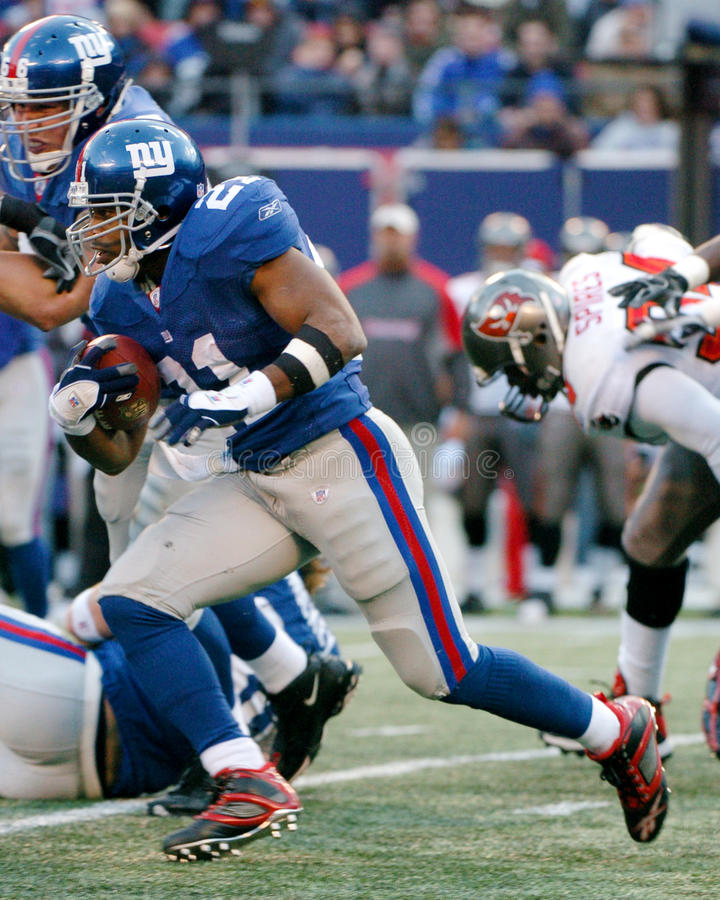 Tiki Barber. Running Back Tiki Barber of the New York Giants in game action againist the Dallas Cowboys. The New York Giants went on to defeat the Dallas Cowboys royalty free stock photos