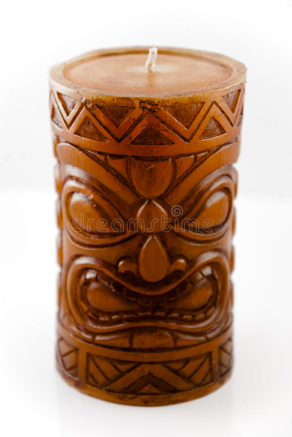 Tiki Candle. A Decorative Tiki Candle on a white background, purchased during my last trip to hawaii stock photo