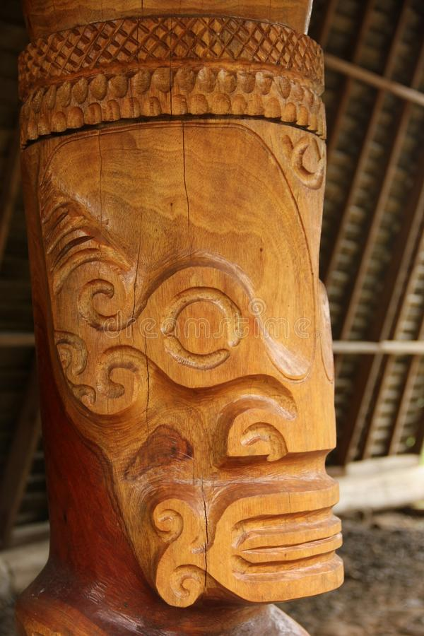 Tiki. A close up of a hand carved wooden Tiki at a ceremonial site on the island of Nuku Hiva, Marquesas Islands, French Polynesia stock photo