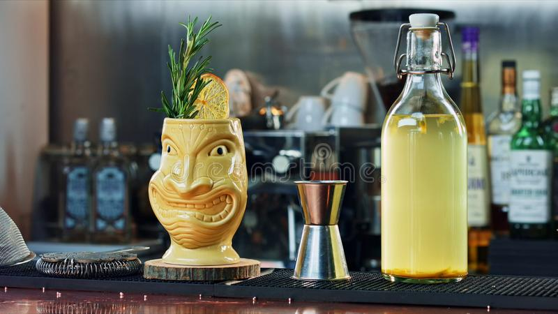 Tiki cocktail at the bar.  stock photography