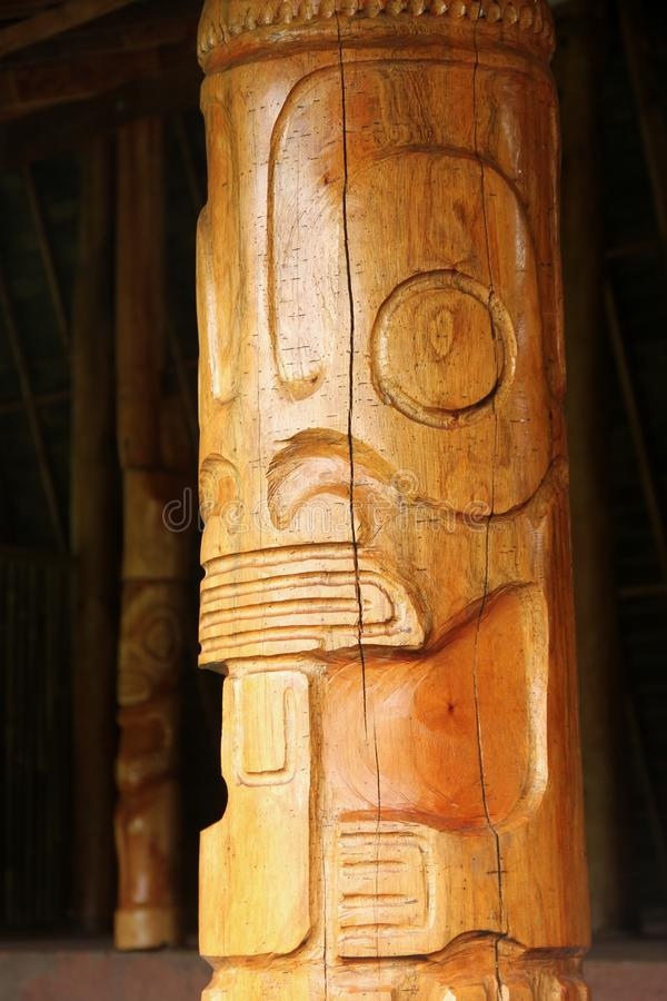 Tiki. A hand carved wooden Tiki at a ceremonial site on the island of Nuku Hiva, Marquesas Islands, French Polynesia royalty free stock photo