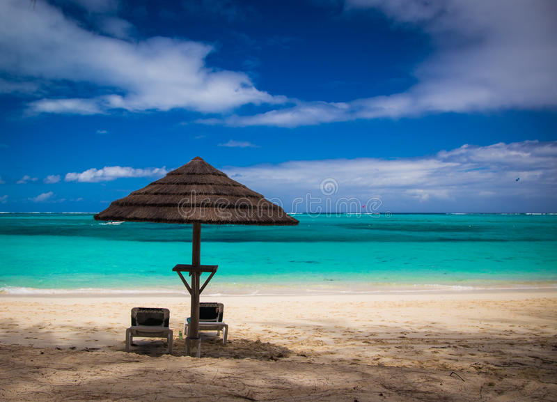 Tiki Hut and lounger royalty free stock images