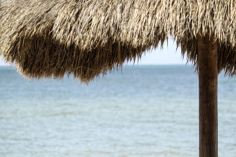 Tiki Hut. View of the ocean from under tiki hut. Copy space available stock photography