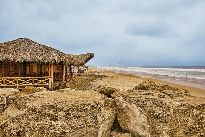 Tiki Huts On The Beach. On a cloudy day stock photos