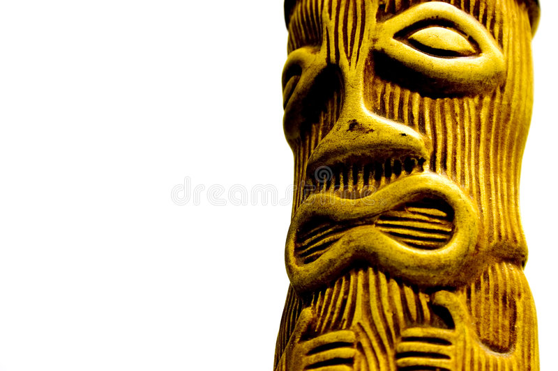Tiki-Man. Ceramic tiki man .. known in polynesian myth and religion as the first man .. isolated against a white background stock photo