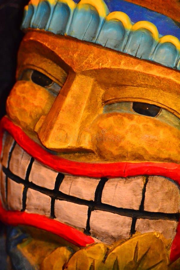 Tiki Man. Brightly colored Tiki Man with creepy face royalty free stock image