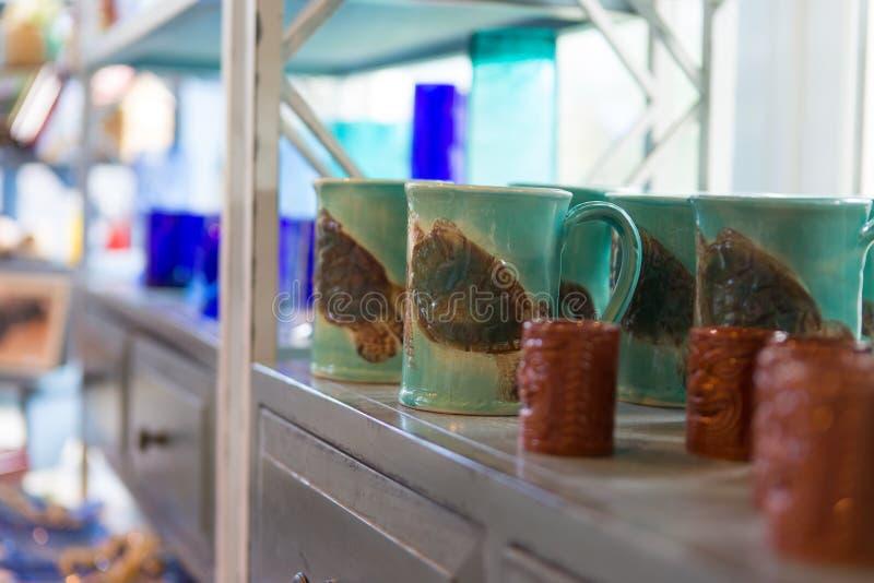 Tiki mug collection in a souvenir shop. Maui, Hawaii stock photography