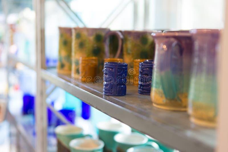 Tiki mug collection in a souvenir shop. Maui, Hawaii royalty free stock images