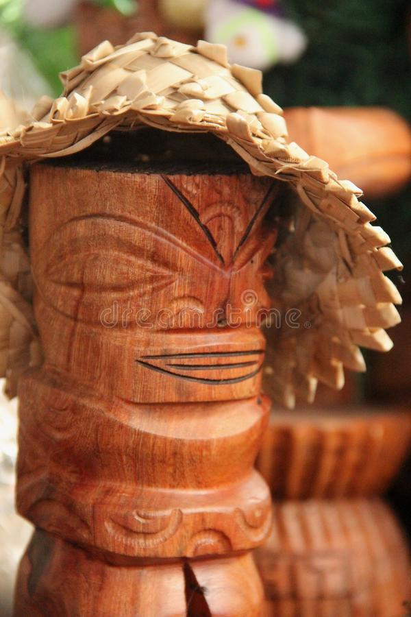 Tiki. A small souvenir Tiki wearing a hat for sale at the market of Papeete, Tahiti, French Polynesia stock image