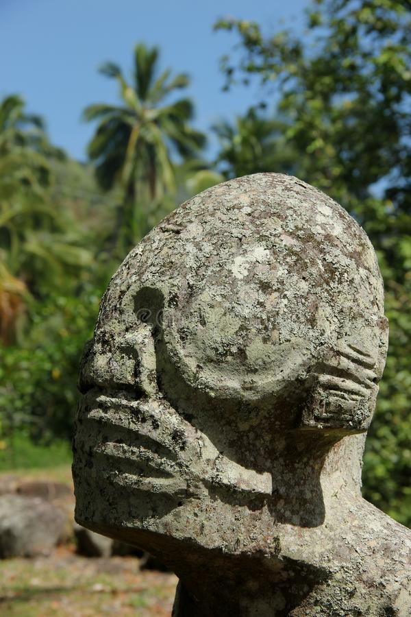 Tiki. A stone Tiki on the island of Nuku Hiva, French Polynesia royalty free stock image