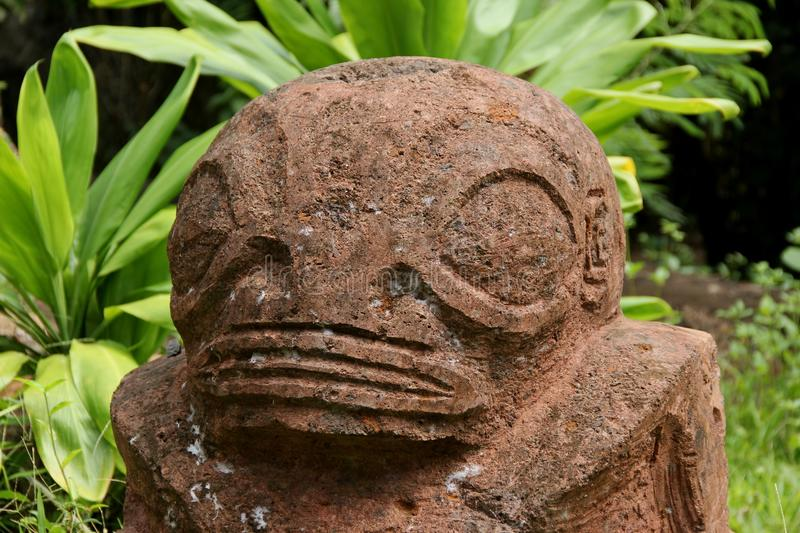 Tiki. A stone Tiki on the island of Nuku Hiva, French Polynesia royalty free stock photography