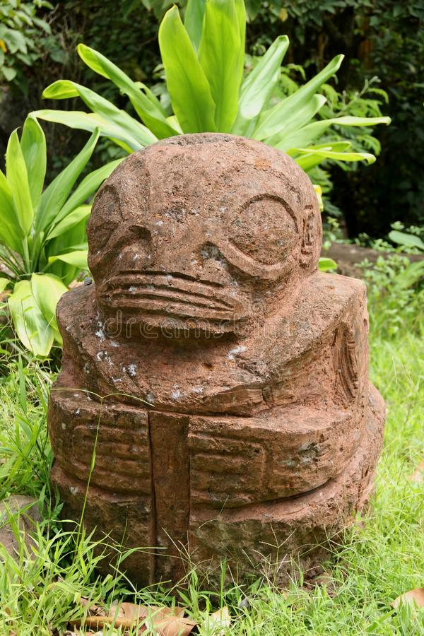 Tiki. A stone Tiki on the island of Nuku Hiva, French Polynesia stock photo