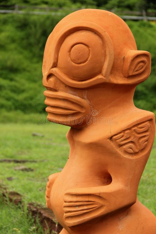 Tiki. A stone Tiki made of terracotta on the island of Nuku Hiva, Marquesas islands, French Polynesia royalty free stock photos