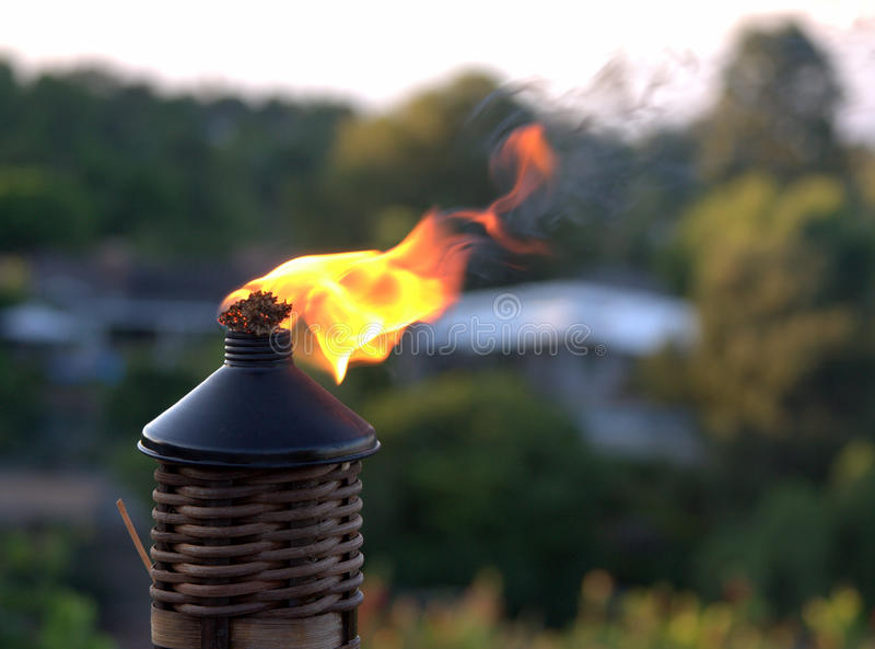 Tiki torch flame. During an outdoor party royalty free stock photo