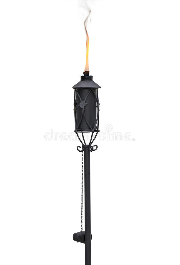 Tiki Torch. Outdoor oil lamp, orTiki Torch, isolated on white. This is also available in a transparent PNG file stock image