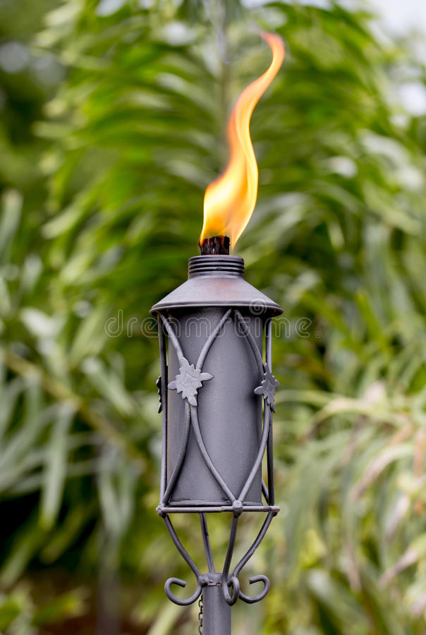 Tiki Torch. Outdoor oil lamp, or tiki torch royalty free stock photography