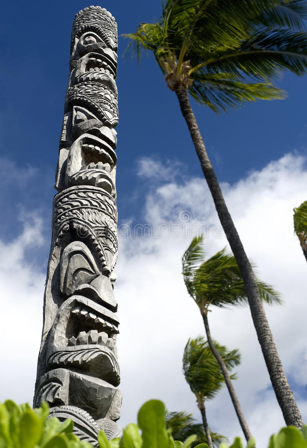 Tiki Totem Pole. This image shows a carved tiki pole in Hawaii stock image