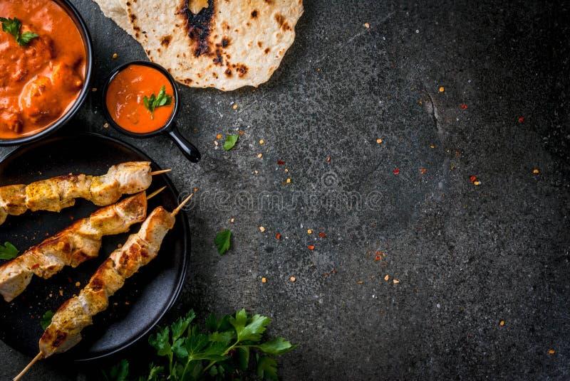 Tikka masala, butter chicken curry. Indian food. Traditional dish spicy chicken tikka masala, butter chicken curry, with indian naan butter bread, spices, herbs stock photo
