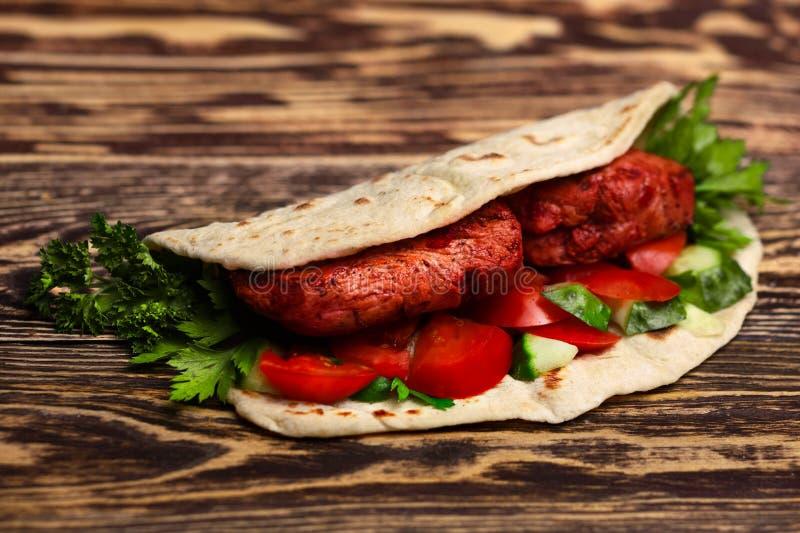 Tikka masala naan sandwich. Chicken Tikka masala naan sandwich. Indian takeaway stock image