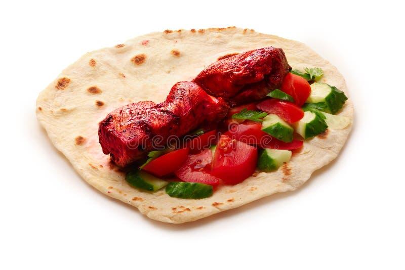 Tikka masala naan sandwich. Chicken Tikka masala naan sandwich. Indian takeaway. Studio shot, infinte depth of field royalty free stock images