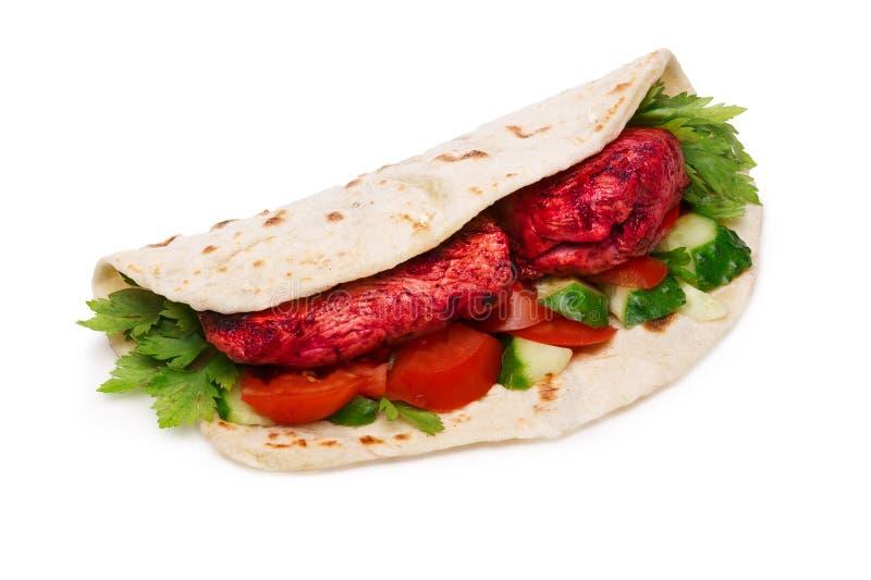 Tikka masala naan sandwich. Chicken Tikka masala naan sandwich. Indian takeaway. Studio shot, infinte depth of field stock images