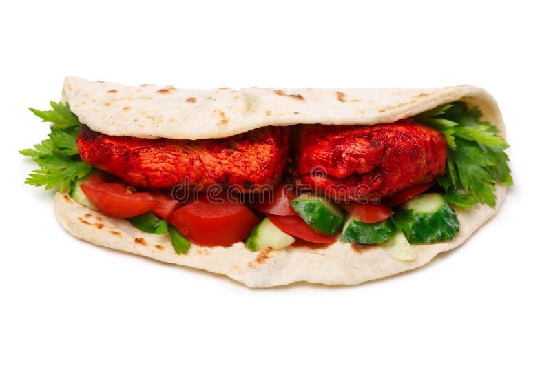 Tikka masala naan sandwich. Chicken Tikka masala naan sandwich. Indian takeaway. Studio shot, selective focus royalty free stock images