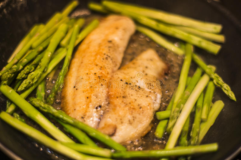 Download Tilapia Fillets With Asparagus Stock Image - Image of tilapia, tips: 77168651