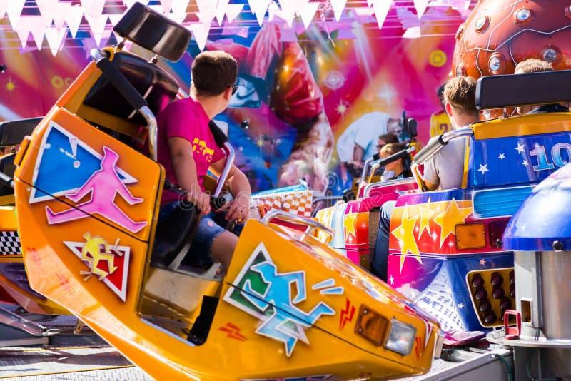Tilburg, Netherlands - 2207.2019: people having a ride on break dance carousel in luna park, funfair called Kermis in Tilburg stock images