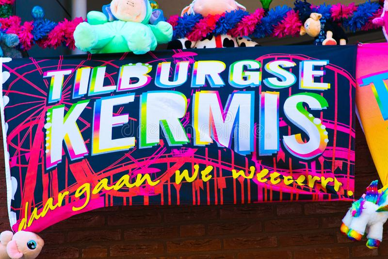 Tilburg, Netherlands - 22.07.2019: Tilburgse Kermis poster towel on decorated balcony in Tilburg royalty free stock photos