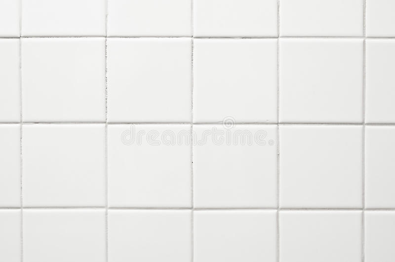 Tile background. Smooth square ecru or white tile background on a grid