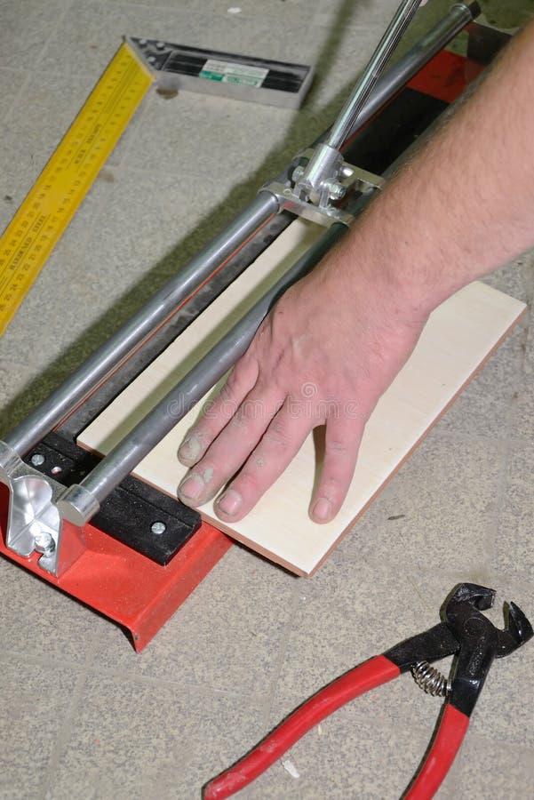 Download Tile cutting process stock image. Image of press, manual - 21129849