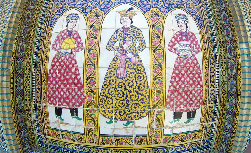 Tile decoration in Qavam house Shiraz Iran. Three figures in traditional Persian dressing, tile decoration on walls of Qavam house also known as Narenjestan e stock photography
