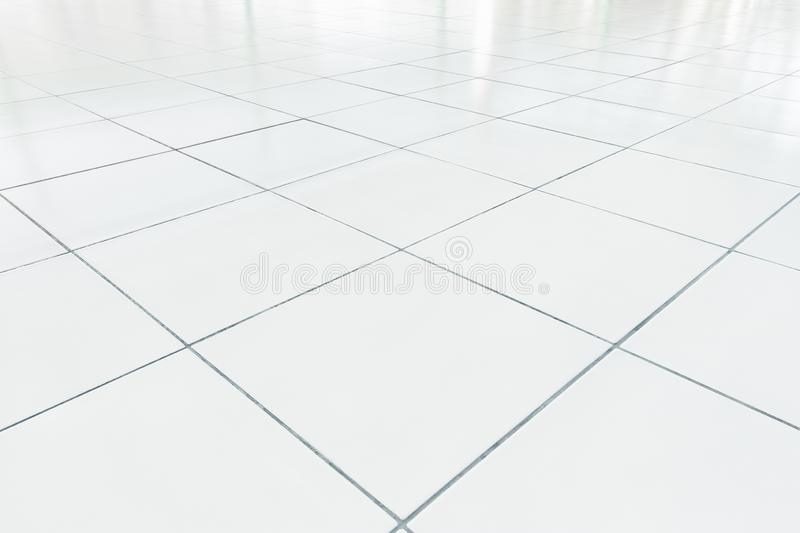 Tile floor background. White tile floor clean condition with grid line for background royalty free stock image