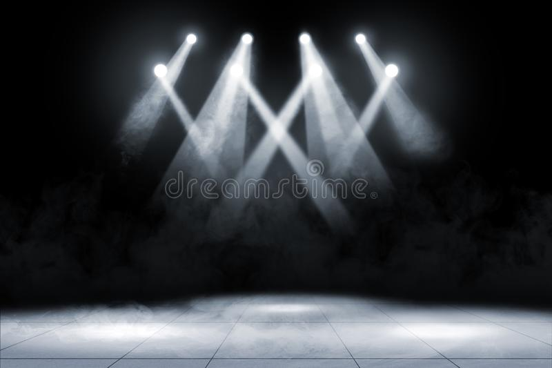 Tile floor with concert spot lighting and smoke royalty free stock image