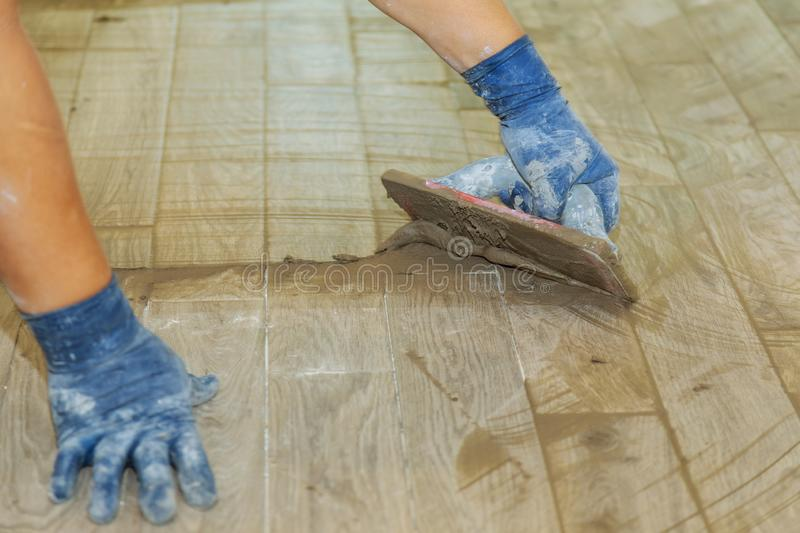 Gray color of new grout tile on for the final step for flooring. Tile Grout Repair Gray color of new grout tile gray for the final step for flooring royalty free stock photos