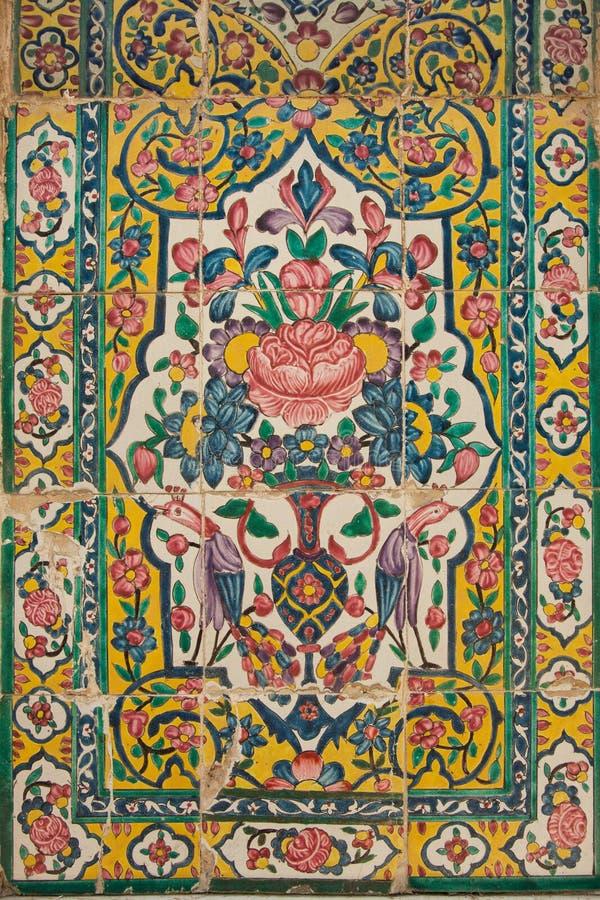Tile panel, khan medrese, shiraz, iran. Old floral tile panel in the khan medrese, shiraz, iran royalty free stock images
