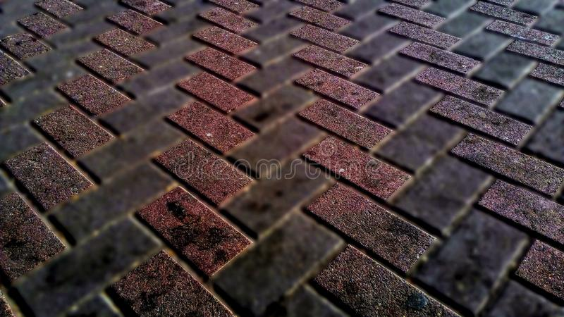Red tile in focus. And gray blurred royalty free stock image