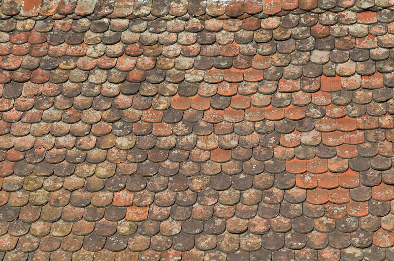 Tile roof. Texture of old tile roof stock photos