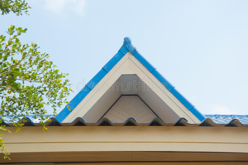 Tile roofing and shake gable details. On modern home royalty free stock images