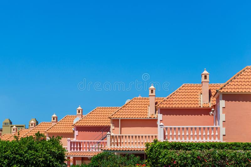 Tile on roofs houses built in row.  royalty free stock images