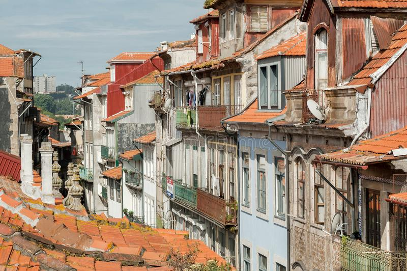 Tile roofs and last floors of old mansions on the streets of city Porto. Cityscape in Portugal.  royalty free stock photo