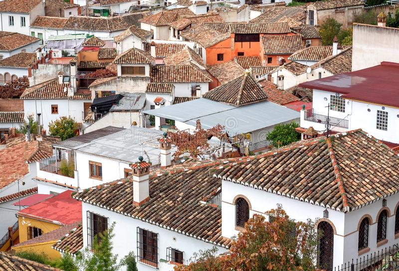 Tile roofs of houses on cityscape of Granada. Landscape of historical town of Andalusia, Spain. Tile roofs of old houses on cityscape of Granada. Landscape of stock images