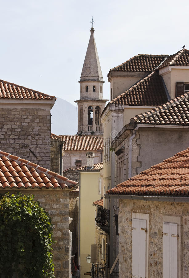 Tile roofs in old town. View the tile roofs and bell-tower in Budva old town, Montenegro stock photos